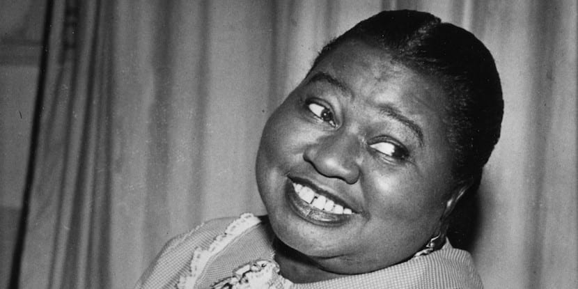 "Hattie McDaniel plays a tune as she portrays the title role of ""Beulah"" in the CBS Radio Network's comedy series in New York City, Aug. 1951. (AP Photo)"